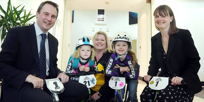 Wright Hassall charity cycling donation